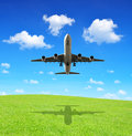 Aircraft passenger airplane landing against blue sky Royalty Free Stock Photography