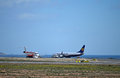 Aircraft refuelling in front of the sea at alicante airport Royalty Free Stock Photos