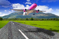 Aircraft starting from the mountain airport runway Royalty Free Stock Photos