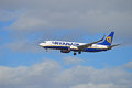 Aircraft with undercarriage down the ryanair flight lowers its as it approaches the airport Royalty Free Stock Photography