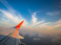 Aircraft wing fly over the cloud Royalty Free Stock Photo