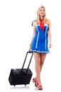 Airhostess with luggage on white Stock Photography
