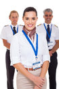 Airhostess and pilots attractive standing in front of on white background Stock Photos