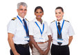 Airline crew beautiful standing on white background Stock Image