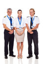 Airline crew of pilots and flight attendant on white background Stock Photography