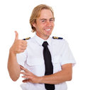 Airline first officer cheerful giving thumbs up against white background Stock Photos