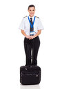 Airline first officer pretty female standing with briefcase isolated on white Royalty Free Stock Photos