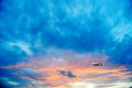 Airline flying in the sky at night beautiful colored sunset over sea Stock Photo