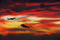 Airline flying in the sky at night beautiful colored sunset over sea Royalty Free Stock Image