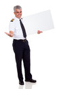 Airline pilot advertising cheerful with blank banner Royalty Free Stock Photography