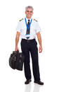 Airline pilot briefcase happy middle aged carrying isolated on white background Royalty Free Stock Photography