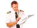 Airline pilot filling in papers Stock Photos