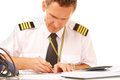 Airline pilot filling in papers Stock Photo