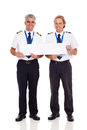 Airline pilots banner smiling holding blank on white background Royalty Free Stock Photo