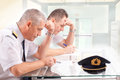 Airline pilots during exam Royalty Free Stock Photo