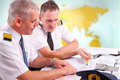 Airline pilots filling in papers in aro two preparing to flight checking flight plan log book are sitting ais air traffic services Stock Image