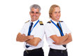 Airline pilots two wearing uniform portrait on white background Royalty Free Stock Photography