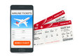 Airline tickets booking online app phone and two boarding passes. Concept of travel, journey or business. Isolated on