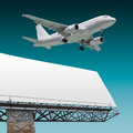 Airliner and billboard Royalty Free Stock Photo