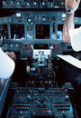 Airliner Cockpit with Pilots Stock Images