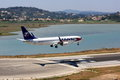 Airliner landing at holiday destination a boeign of travel service airlines lands corfu airport a popular Stock Image