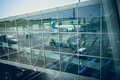 Airliner reflecting in glass wall of modern airport terminal Royalty Free Stock Photo
