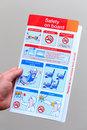 Airliner safety card hand holding airline concept for aviation Royalty Free Stock Photography