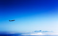 Airliner in the stratosphere over mountains and clouds Royalty Free Stock Images