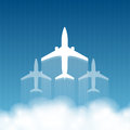 Airliners flying from behind the clouds on an abstract background of the sky flying Stock Photography