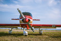Airplane at the airfield red plane propeller wings and fuselage of aircraft small aviation transport travel on sky Stock Photography