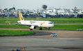 Airplane at airport prepare take off ho chi minh city viet nam may tan son nhat to transport tiger plane moving on runway with Stock Photography