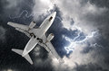 Airplane approach at the airport landing in bad weather storm hurricane rain llightning strike Royalty Free Stock Photo