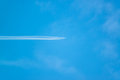 Airplane in blue sky background Stock Photo