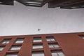 Airplane Between Buildings
