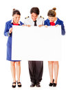 Airplane cabin crew with banner Stock Images