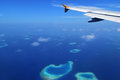 Airplane carrying holiday makers landing in maldives useful for describing scenarios Stock Photos