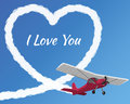 Airplane drawing a cloudy love on the clear sky background Stock Photos