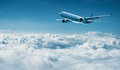 Airplane flies above clouds - air travel Royalty Free Stock Photo