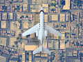 Airplane fly above city. top view. 3d rendering