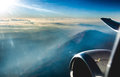 Airplane flying above the clouds Royalty Free Stock Photo