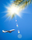 Airplane flying in blue sky Stock Images