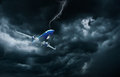 Airplane flying and landing in storm Royalty Free Stock Photo