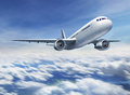 Airplane flying over cloudy sky Royalty Free Stock Photo