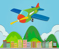 Airplane flying over a town Royalty Free Stock Photo