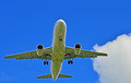Airplane flying on sky commercial airliner approach to airport Royalty Free Stock Photography