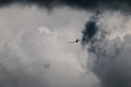 Airplane flying into stormy clouds sky in ireland Royalty Free Stock Images