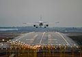 Airplane landing airliner late evening to runway Stock Photos