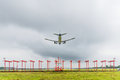 Airplane is landing at the airport before storm approaching Royalty Free Stock Photo