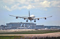 Airplane Airbus A340-300 landing to runway Royalty Free Stock Photo