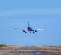 Airplane landing to runway Royalty Free Stock Photo